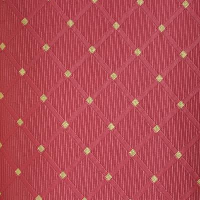 Carta da parati piccoli rombi rossi con inserti giallo oro chiaro