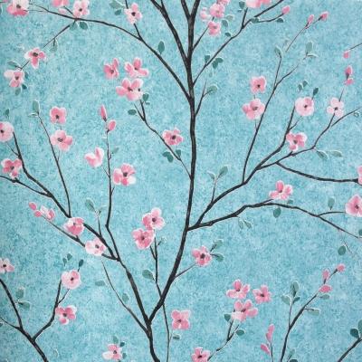 Carta da parati con fiorellini rosa sfondo azzurro